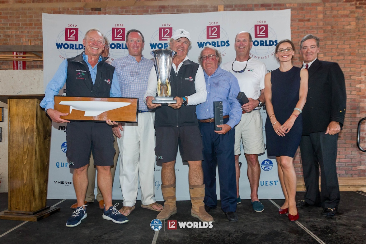 Courageous syndicate and crew member Ralph Isham (middle) accepts the Waypoints Series vintage keeper trophy at the 2019 12 Metre Worlds (Photo Credit: Ian Roman).
